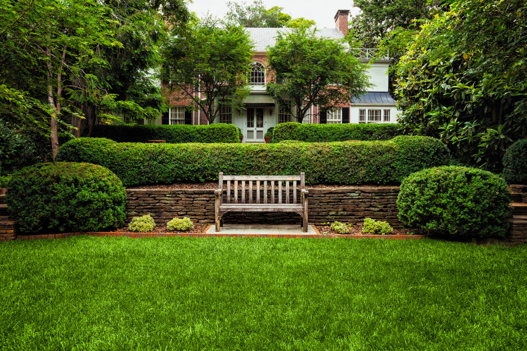 Bench in front of house lawn